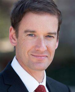 Dr. Christopher Davidson in Suit